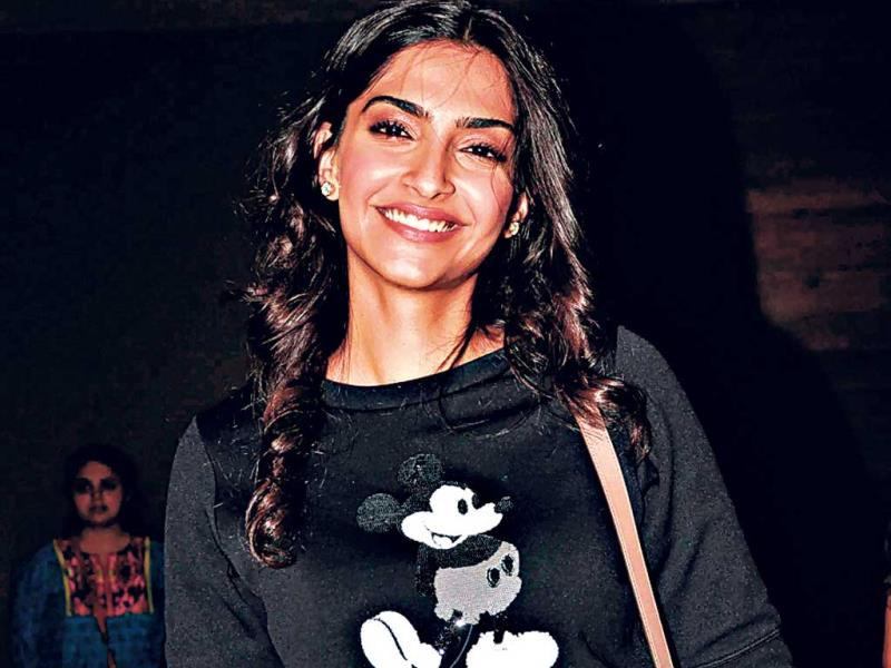 Actor Sonam Kapoor ditches the glam doll look and goes old school with a Mickey Mouse print tee.