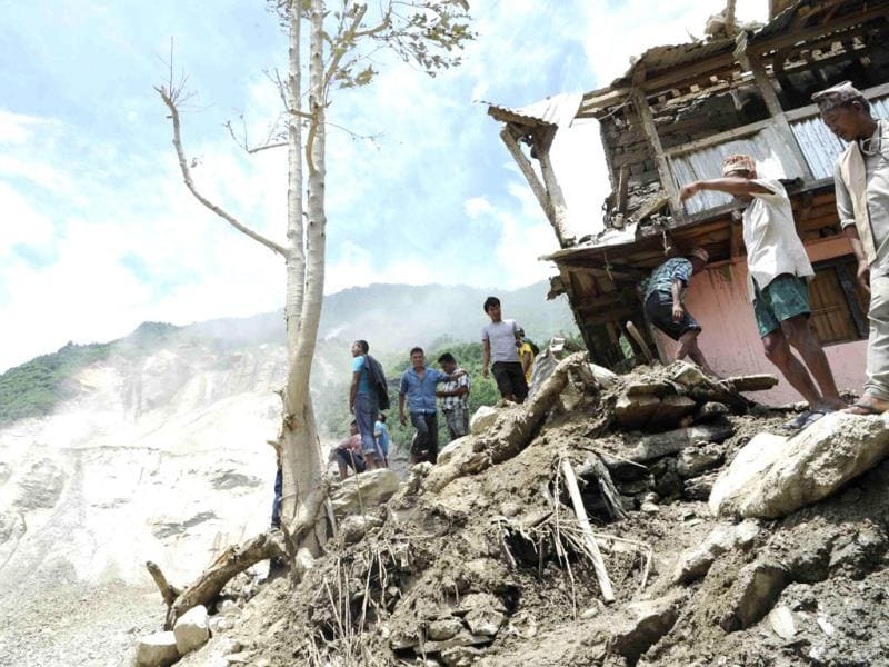 People are seen at the landslide area in Sindhupalchowk district in Nepal. (Reuters photo)