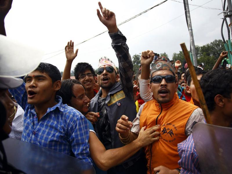 Supporters of Prime Minister Narendra Modi cheer as he walks out of the premises of Pashupatinath Temple in Kathmandu. (Reuters)