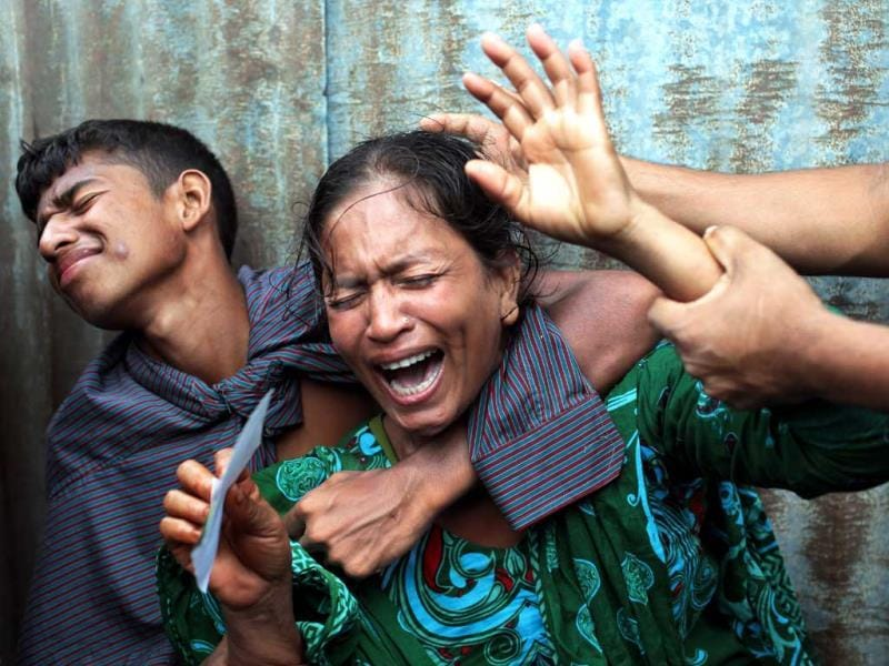 Bangladeshi woman Munni, whose daughters are missing, cries as rescuers search the River Padma after a passenger ferry capsized in Munshiganj district, Bangladesh. (AP Photo)