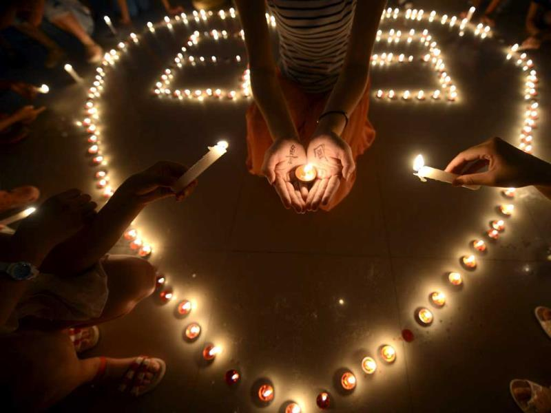 Children in a residential block hold a candlelight vigil for the victims of the August 3 Yunnan province earthquake in Yangzhou in east China's Jiangsu province. (AP Photo)