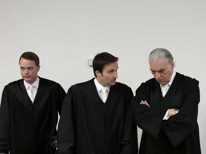 Formula One boss Bernie Ecclestone (right) waits besides his lawyers for the start of his trial in the regional court in Munich, southern Germany. (AP Photo)