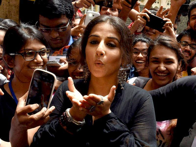 Blowing away troubles: Vidya Balan with students during distribution of smartcanes for the visually challenged. (PTI Photo)