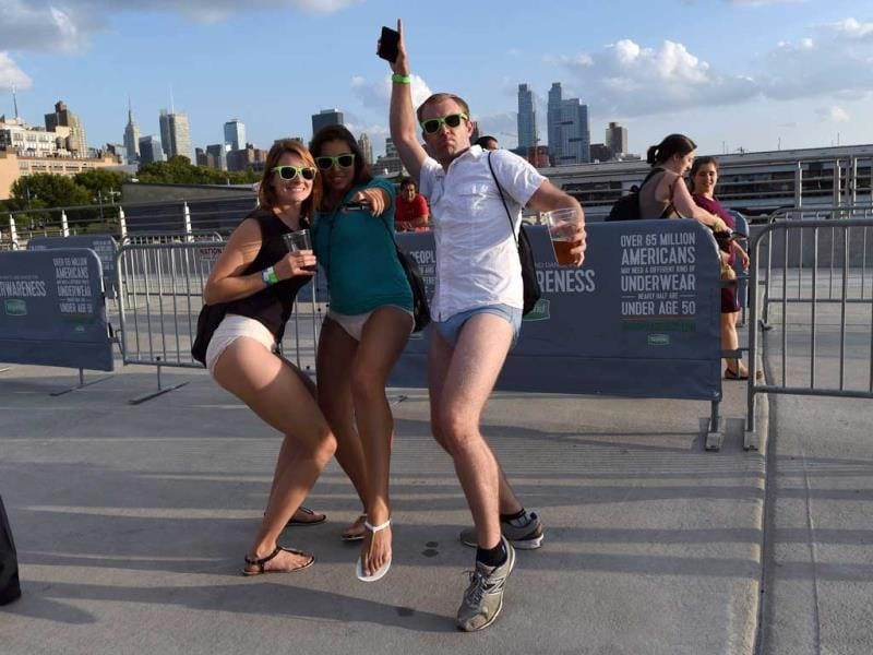 People arrive at Pier 97 in New York for the 'Drop your pants and dance for underwareness' to help support the 65 million Americans who experience bladder leakage by bringing the condition and depend underwear out of hiding. (AFP Photo)
