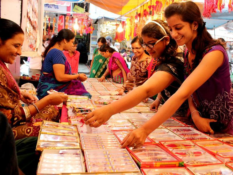 Girls purchase rakhis ahead of Rakshabandhan in Indore on Thursday. (Shankar Mourya/HT photo)