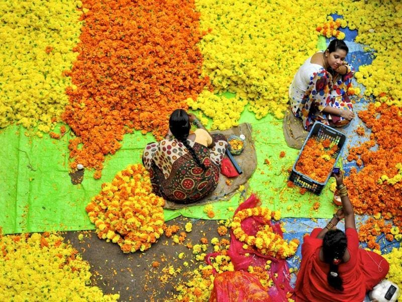 Vendors sit at a flower market in Bangalore. (Reuters/Abhishek N. Chinnappa)
