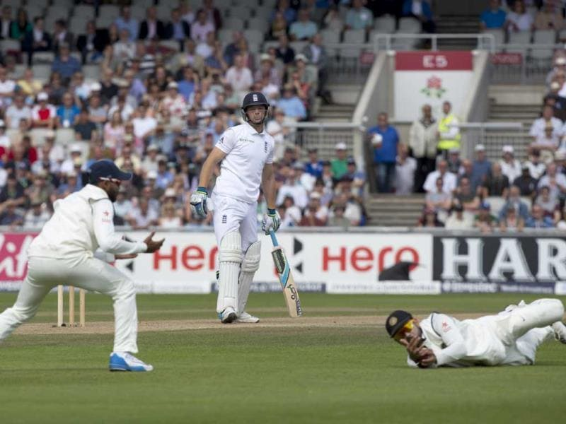 England's Jos Buttler (C) survives a catching attempt by Virat Kohli on the third day of the fourth Test at Old Trafford cricket ground, in Manchester, England. (AP Photo)