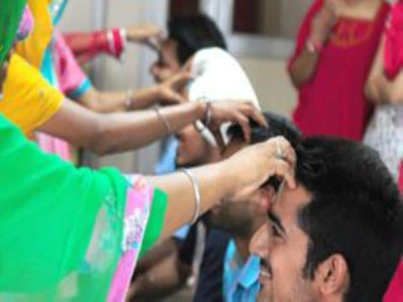 Center for social work students celebrated Rakhi with HIV positive women at Punjab university campus on Saturday.Ravi Kumar/HT