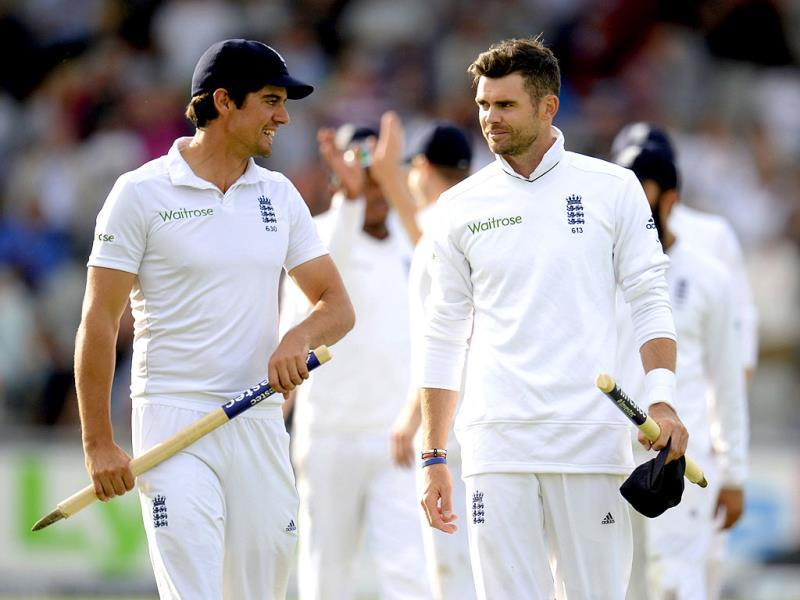 England captain Alastair Cook (L) and James Anderson leave the field after England won the fourth Test against India on Day 3 at Old Trafford in Manchester. (Reuters Photo)