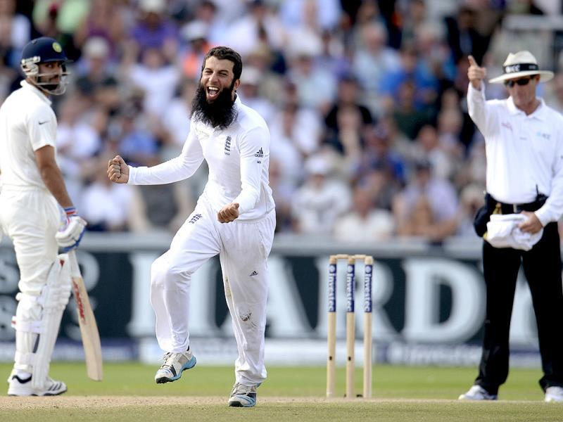 England's Moeen Ali (C) celebrates after getting a wicket during the third day of the fourth Test between England and India at Old Trafford in Manchester. (Reuters Photo)