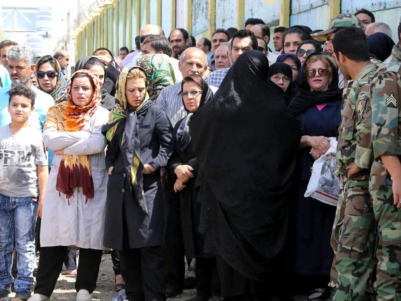 Iranian onlookers gather at the scene of a plane crash near Tehran's Mehrabad airport. (AFP photo)