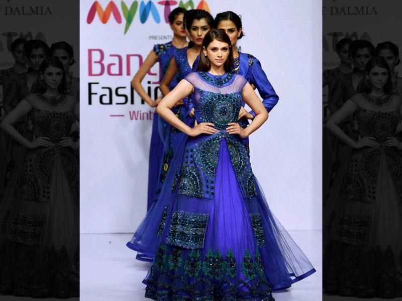 Actor Aditi Rao Hydari on the ramp to showcase the creation of designer Lalit Dalmia during the first day of Bangalore Fashion Week in Bengaluru on August 7, 2014. (PTI Photo)
