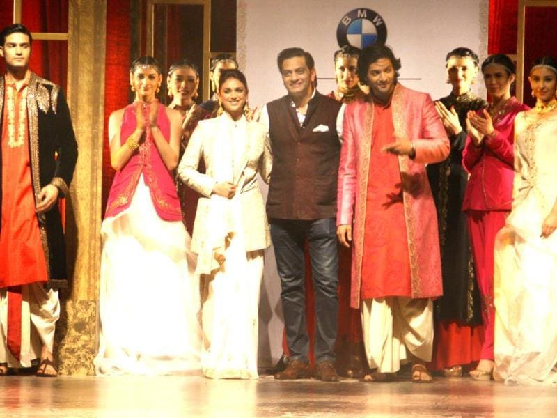 Actors Aditi Rao Hydari and Ali Fazal showcasing designer Raghavendra Rathore's creations during BMW India Bridal Fashion Week 2014 in New Delhi on August 8, 2014. (IANS)