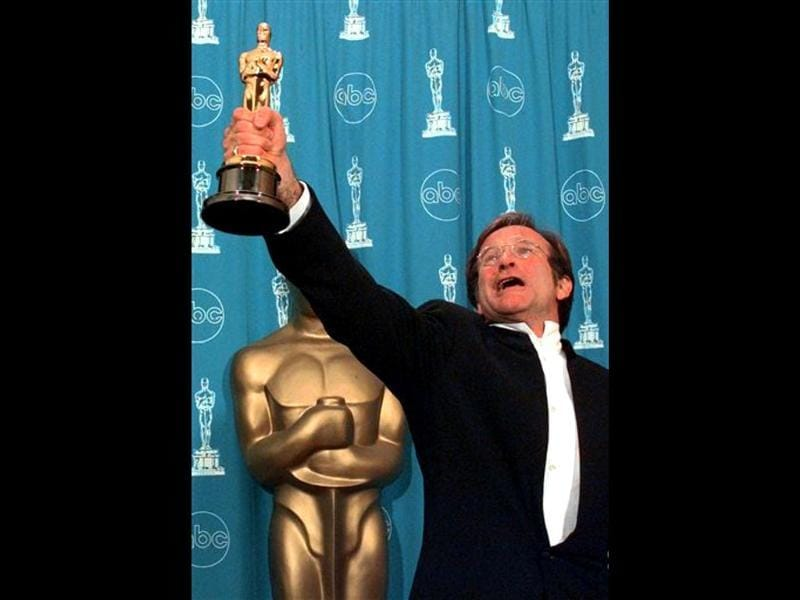 This March 23, 1998 file photo shows Robin Williams holding his Oscar high backstage at the 70th Academy Awards at the Shrine Auditorium in Los Angeles after won Best Supporting Actor for Good Will Hunting. (AP Photo)