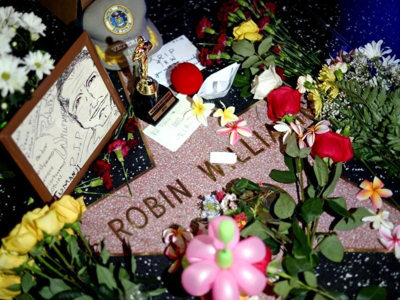 Flowers are placed in memory of Robin Williams on his Walk of Fame star in the Hollywood district of Los Angeles on Monday. Williams, the Academy Award winner and comic supernova whose explosions of pop culture riffs and impressions dazzled audiences for decades died Monday in an apparent suicide at his San Francisco Bay area home. (AP photo)
