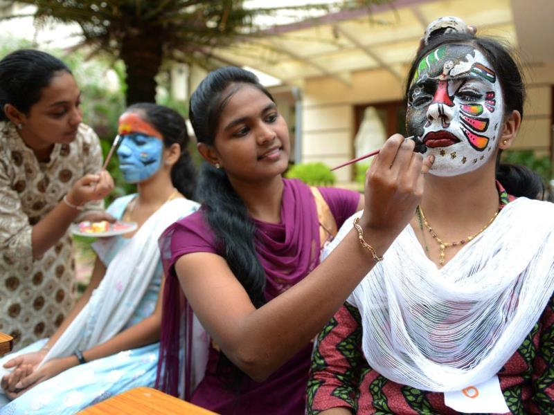 Nursing students participate in a face painting competition at Vijay Marie College of Nursing in Hyderabad on the occasion of upcoming Independence Day. AFP Photo
