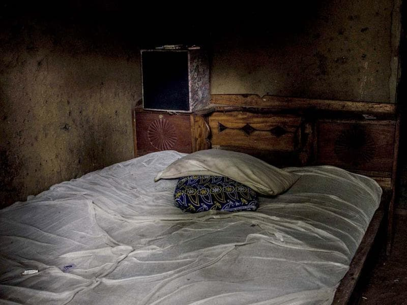 The unmade bed of Alhaji Abbah, who reportedly died of Ebola, in the village of Njala Giema, Sierra Leone. (AP Photo)