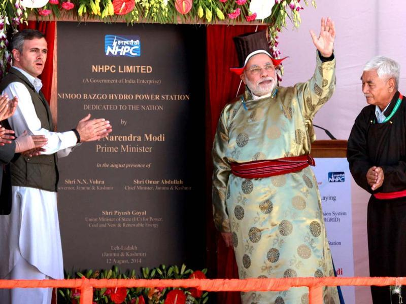 Prime Minister Narendra Modi (C) and the chief minister of Jammu and Kashmir Omar Abdullah (2L) take part in the opening of the Nimmo-Bazgo hydropower project in Leh. (AFP Photo/PIB)