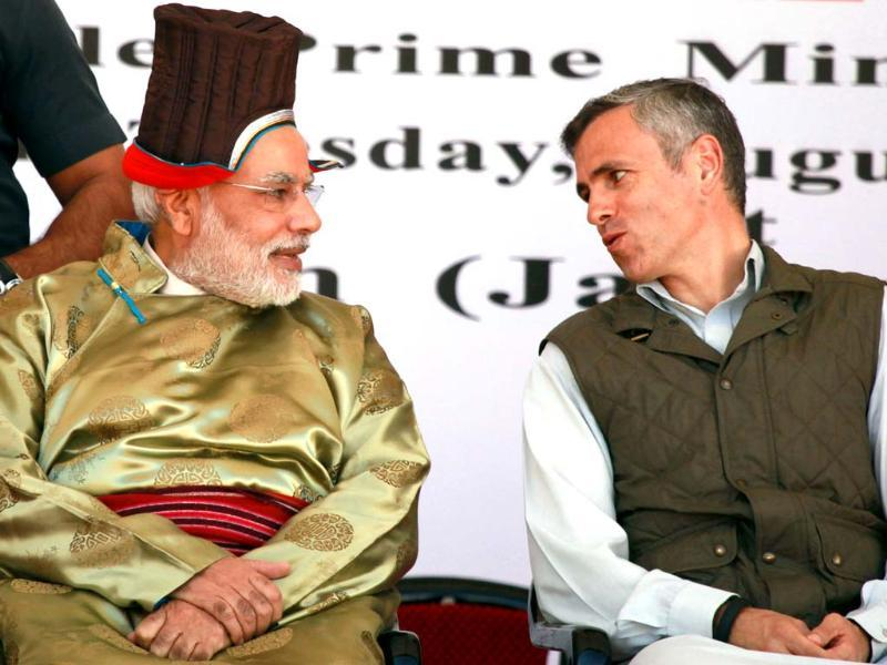 Prime Minister Narendra Modi and chief minister of Jammu and Kashmir Omar Abdullah talk during the opening of the Nimmo-Bazgo hydropower project in Leh. (AFP Photo/PIB)