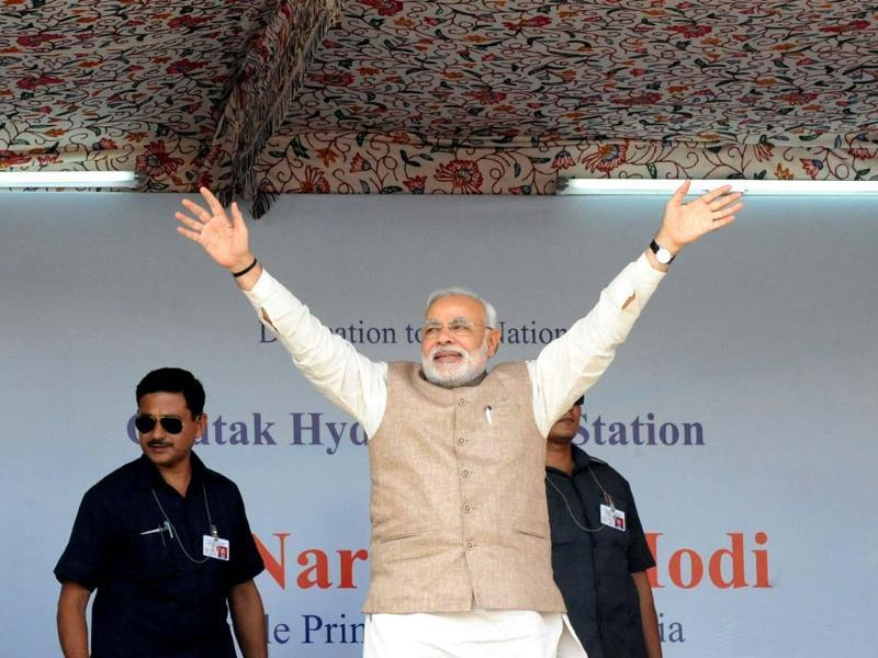 Prime Minister Narendra Modi waves to supporters during a public rally in Kargil. (AFP Photo)