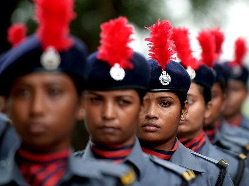 An armed women forces contingent wait to participate in the march past during the full dress rehearsal for the 68th Independence Day celebrations at The Red Road in Kolkata. (AFP Photo)