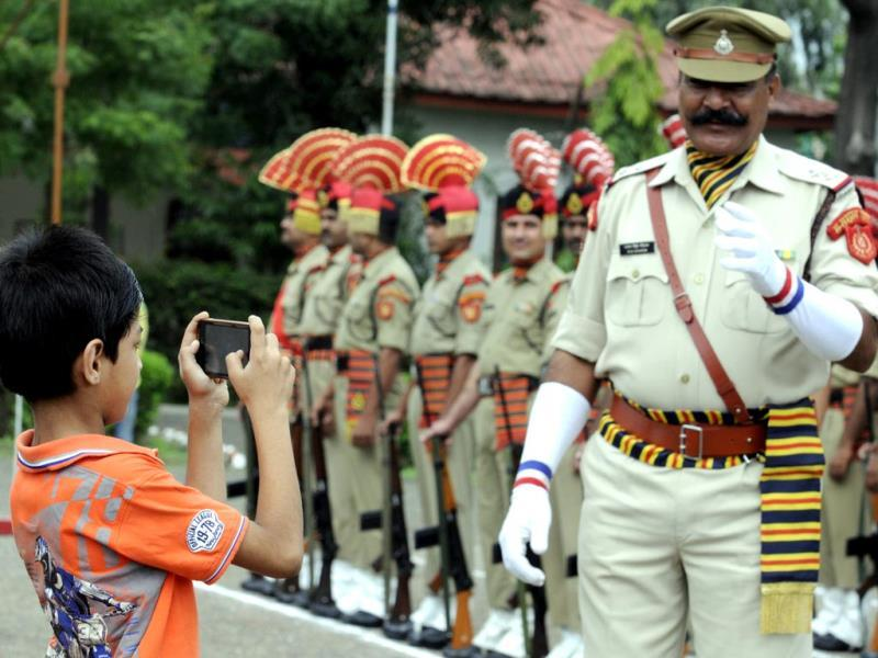 A boy clicks a picture of parade rehearsal at Mahesh Guard line in Indore. (Amit K Jaiswal/HT photo)