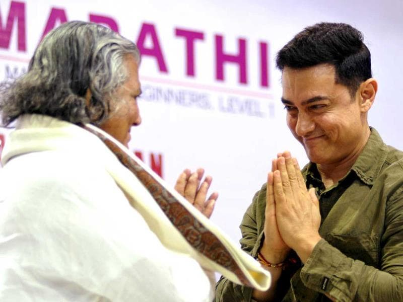 Happy promoting Marathi: Aamir Khan at the launch of Communicative Marathi, Level 1 book titled My Marathi. (AFP Photo)