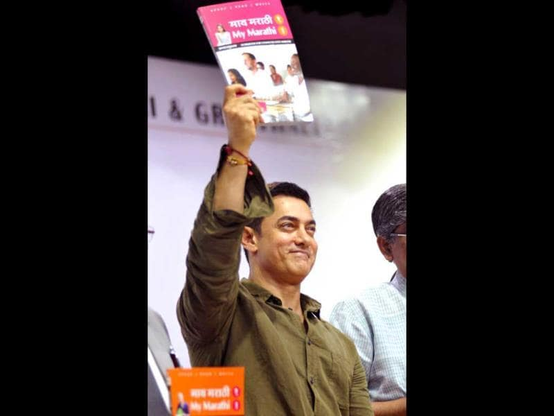That's what it's all about, this book: Aamir Khan during the launch of Communicative Marathi, Level 1 book titled My Marathi. (AFP Photo)
