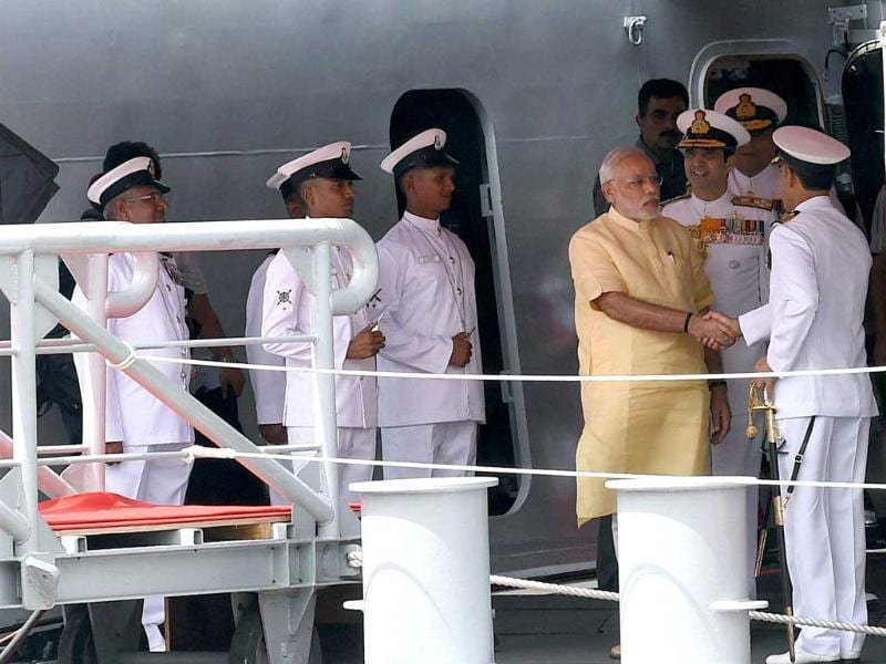PM Narendra Modi and admiral RK Dhowan, chief of naval staff along with other naval officers during the commissioning ceremony of INS Kolkata at the Naval Dockyard in Mumbai. (PTI photo)