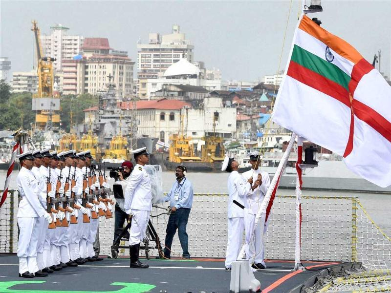 Naval officers leading the commissioning ceremony of INS Kolkata at the Naval Dockyard in Mumbai. (PTI photo)