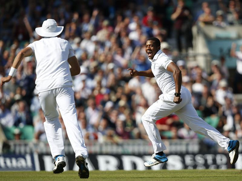 England's Chris Jordan (R) celebrates a wicket during the third day of the fifth Test against India at The Oval in London. (AP Photo)
