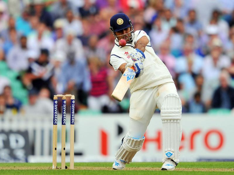 MS Dhoni hits a six on the first day of the fifth Test match against England at The Oval in London. (AFP Photo)