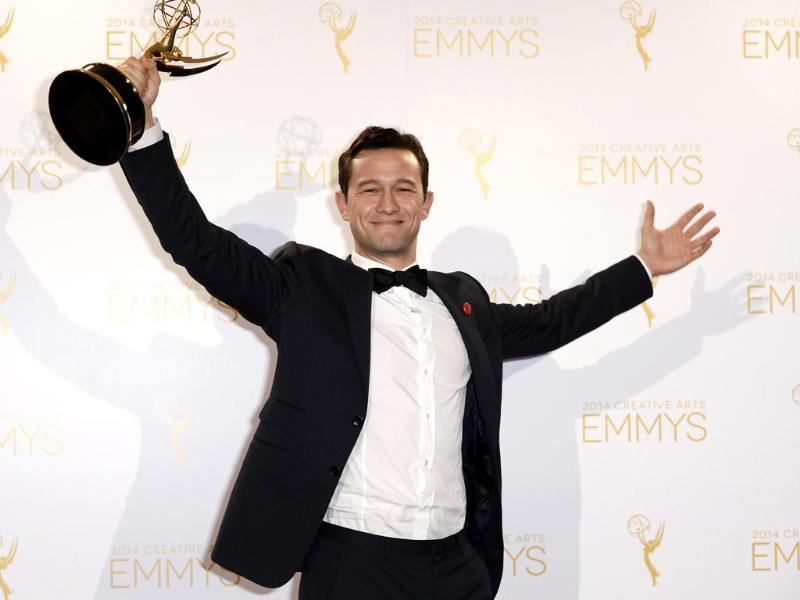 Actor Joseph Gordon-Levitt poses backstage with the Emmy for Outstanding Creative Achievement In Interactive Media Social TV Experience for hitRECord on TV. (Reuters)