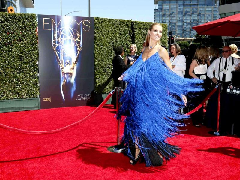 Model Heidi Klum twirls in her dress as she poses at the 2014 Creative Arts Emmy Awards in Los Angeles. (Reuters)