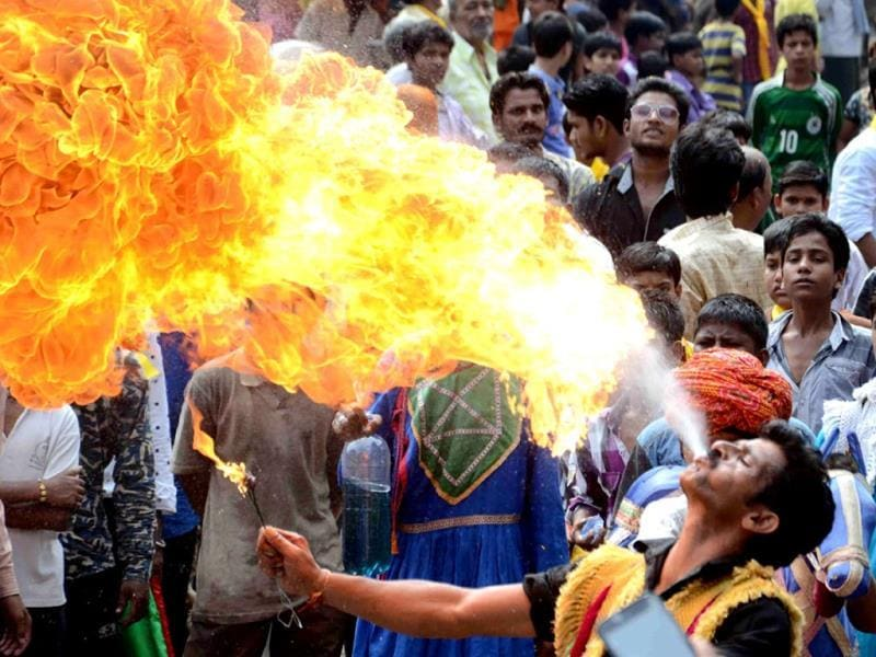 A man performs a stunt during a Janmashtami procession taken out from Shree Jee temple in Bhopal on Sunday. (HT photo)