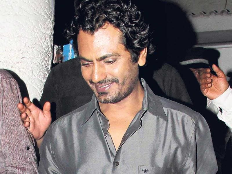 We also caught the shy Nawazuddin Siddiqui quietly sneaking away from the limelight. (Photos: Yogen Shah)