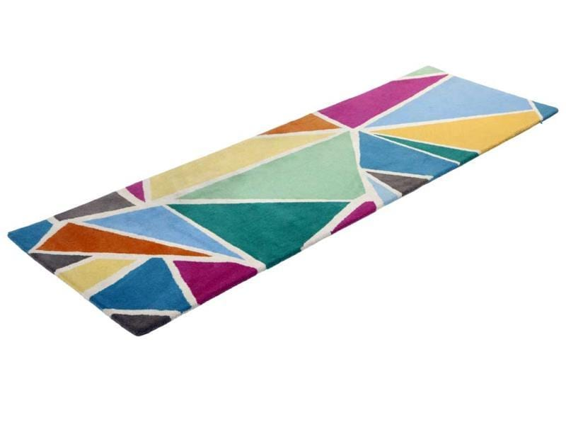 This hand-tufted rug from Habitat features a quirky and colorful geometric motif in contrasting pastels.