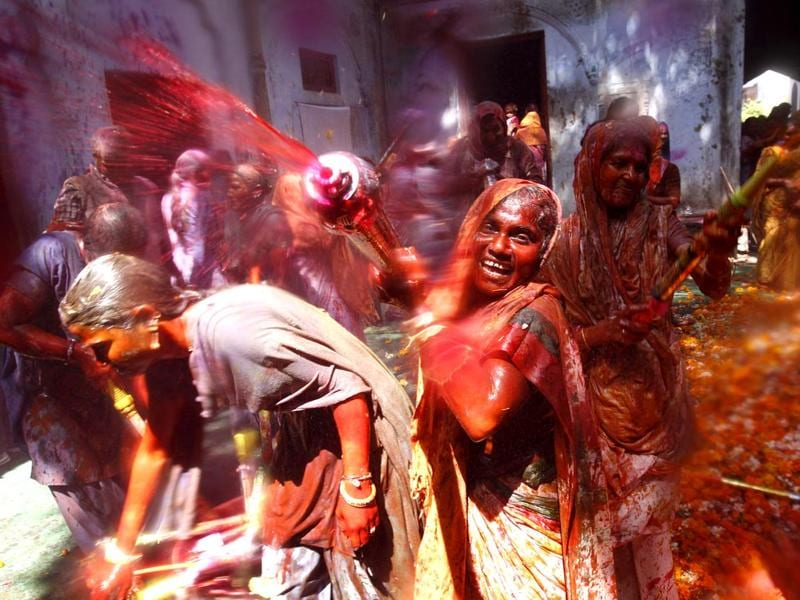 Widows throw colour at each other as part of Holi celebrations organized by NGO Sulabh at the Meera Sahbhagini Ashram in Vrindavan. (Ajay Aggarwal/HT Photo)