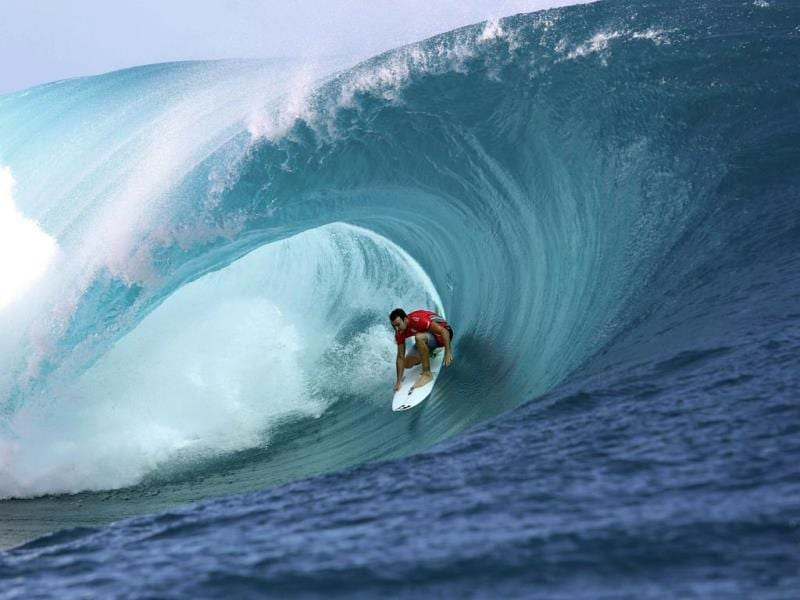 Australia's Joel Parkinson rides a wave during the 14th edition of the Billabong Pro Tahiti surf event, part of the ASP (Association of Surfing Professionals) world tour, in Teahupoo, on the French Polynesian island Tahiti. (AFP Photo)