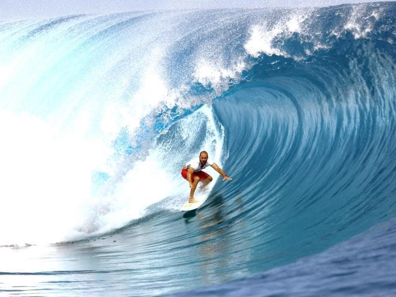 USA's CJ Hobgood rides a wave on August 18, 2014 during the 14th edition of the Billabong Pro Tahiti surf event, part of the ASP (Association of Surfing Professionals) world tour, in Teahupoo, on the French Polynesian island Tahiti. (AFP Photo)