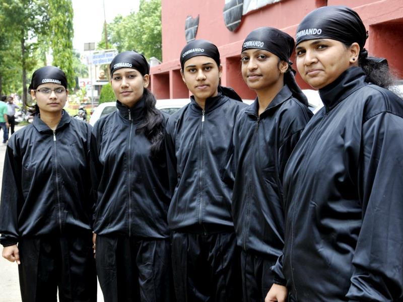 Members of commando force of Sarojini Naidu Girls' PG College, who have been trained to protect fellow students from harassment, in Bhopal on Tuesday. (Gagan Nayar/HT photo)