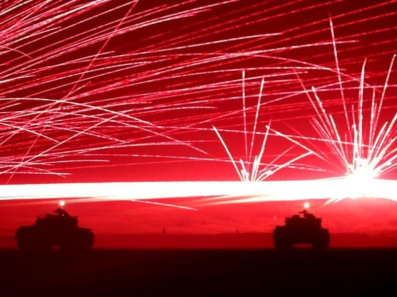 Tracer bullets ricochet off their targets as Japanese Ground Self-Defence Force tanks fire their machine guns during a night session of an annual training exercise at Higashifuji training field near Mount Fuji in Gotemba. (Reuters)