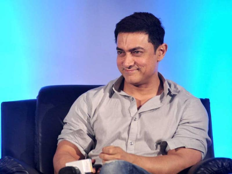 An amused Aamir Khan at the launch of 'Young Inspirators Network' in Mumbai on August 19, 2014. (AFP Photo)