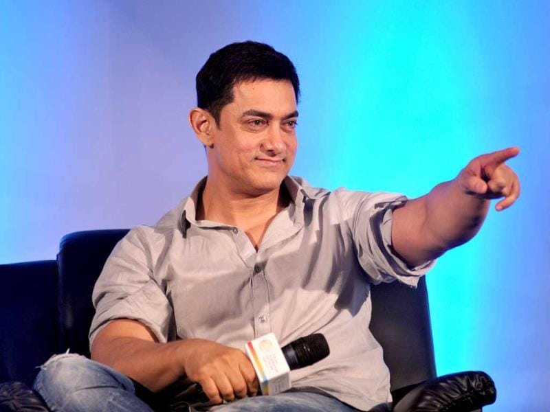 Happy to promote young talent: Aamir Khan points during the launch of Young Inspirators Network in Mumbai on August 19, 2014. (AFP Photo)