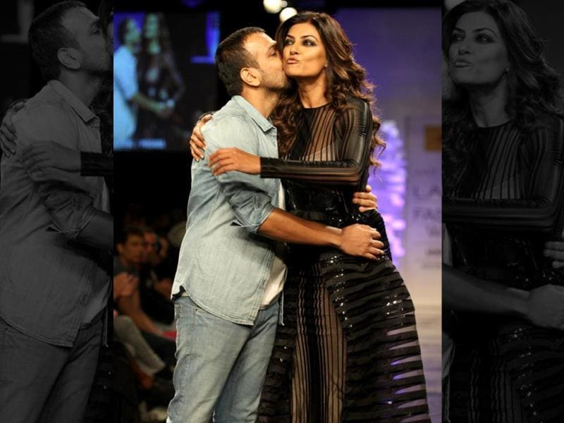 Fashion designer Amit Agarwal walks with Sushmita during his show. (Photo: IANS)