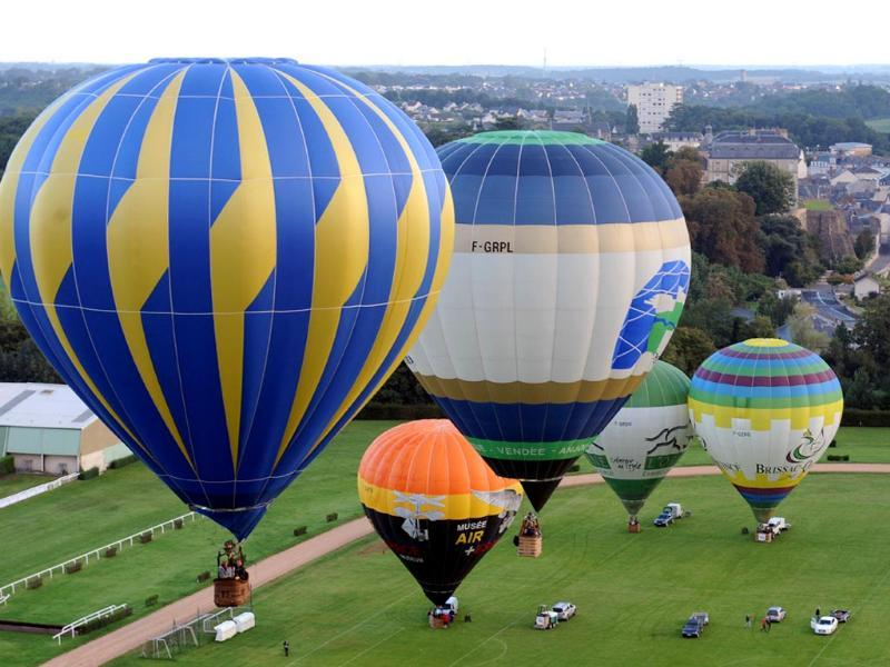 Hot air balloons take off during the 40th French Hot Air Balloon Championship. (AFP Photo)