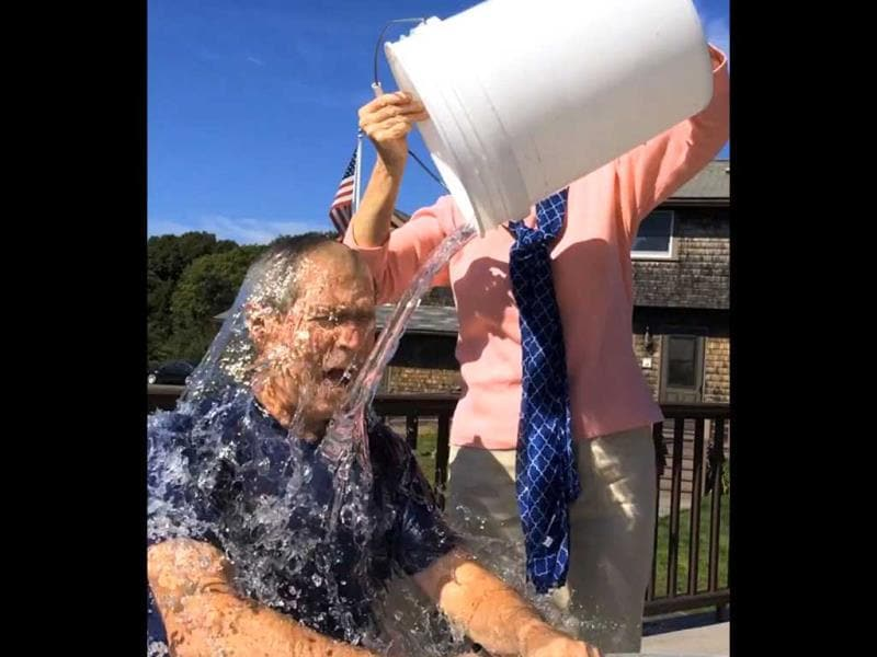 Former US President George W. Bush participates in the ice bucket challenge with the help of his wife, Laura Bush. (AP Photo)