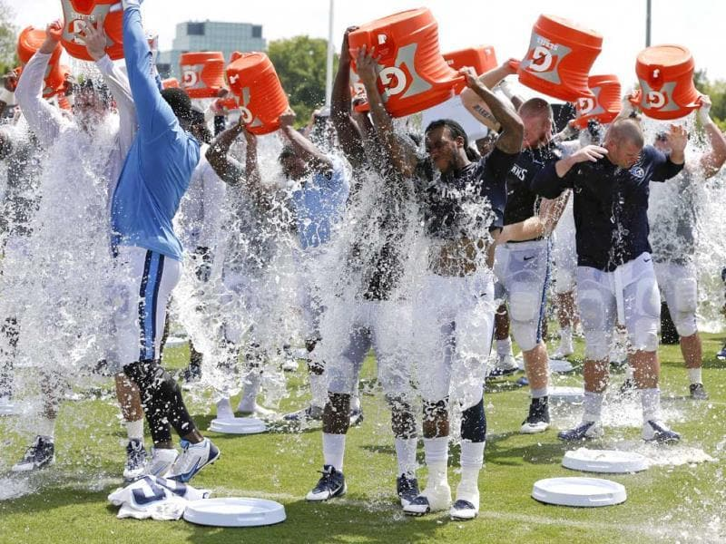 American football team, Tennessee Titans players take part in the ALS Ice Bucket Challenge and pour ice water over their heads after NFL football practice Wednesday.(AP Photo)