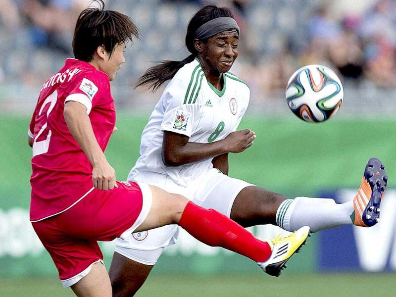 Nigeria's Courtney Dike (R) and North Korea's Song Kyong Hui vie for the ball during a Fifa U-20 women's World Cup semifinal in Moncton, New Brunswick. (AP Photo)