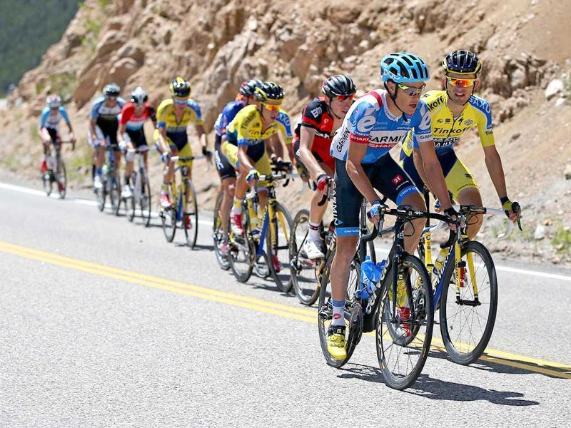 Tom Danielson of the United States sets the pace and is followed by Rafal Majka of Poland on the first climb of Monarch Mounatin during stage three of the 2014 USA Pro Challenge from Gunnison to Monarch Mountain. (AFP Photo)